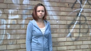moody-teenager-in-urban-setting-with-dolly